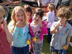 Mound students tasting all the different types of tomatoes at the Houweling's booth at Farm Day 2013.