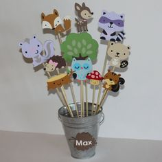 I love this centerpiece forest and woodland friends, such a hot trend right now too!