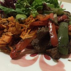 Pepper steak oven roasted sweet potatoes and greens - Preheat oven at 375 and cut sweet potatoes to your liking.  Toss in olive oil and salt and pepper and bake for 30 mins until crispy. -Season and cook steak in a pan once cooked add peppers.  Cook until peppers are tender. (I added mushrooms but you don't have to)  #paleo #paleodiet #mealprep #mealprepmonday #yum #glutenfree #wheatfree #recipe #foodie #food #nomnom by im_a_tough_cookie