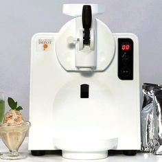 World's first at-home soft serve ice cream machine! Patented technology makes batch after batch of commercial-quality soft serve at home! Commercial Ice Cream Machine, Soft Serve Machine, Dairy Free Mashed Potatoes, Ice Cream Maker, Kitchen Gadgets, Kitchen Tools, Frozen Yogurt, Mixed Drinks, Ice Cream Sandwiches