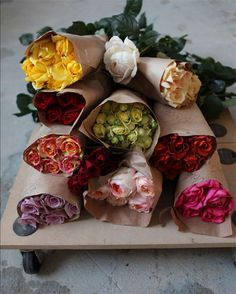 roses wrapped in brown paper. love it.