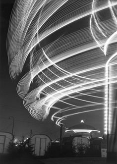 Toni Schneiders - Carousel on the Cathedral, Hamburg, 1950.