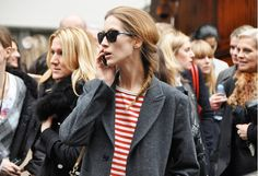 Fashion Week street chic with stripes and sunnies.   Tommy Ton