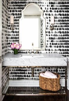 Black and white wallpaper bathroom with pop of pink | How to update a guest bathroom
