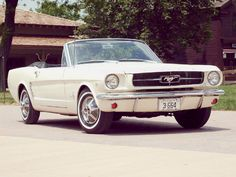 1964 Ford Mustang Convertible - Our neighbor got this car when she graduated from high school...She had long straight blond hair...That's what we all wanted, plus a cute surfer boyfriend