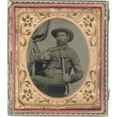 Sixth Plate Tintype of Armed Cavalry Sgt.,unidentified, well posed, having more character and animation that most Civil War images. The bearded sergeant presents a prop Colt Navy to the camera while grasping his M1840 wristbreaker. On his belt is another holstered pistol, possibly an imported Kerr with lanyard ring issued to some western regiments equipped in St. Louis.