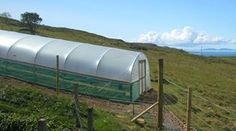 Can a Polytunnel be built on a slope? Construction advice from Premier Polytunnels