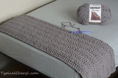 Simple crochet blanket using Bernat Blanket yarn. How many skeins do you need to cover a twin size bed? Hook size, stitches and tips here. So easy you don't need a pattern!