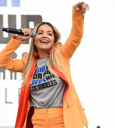British singer Rita Ora also turned up to the protest, sporting an attention-grabbing bright orange ensemble March For Our Lives, Singing Happy Birthday, Slogan Tee, Rita Ora, Celebs, Celebrities, Cool Bands, Crowd, Celebrity Style