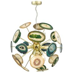 The Achates 9 Light Ceiling Light is a truly striking piece. Spherical in shape and boasting a gold finish throughout, the pendant features unique pieces of agate, of which are all naturally formed within volcanic rock. Each piece of agate are blends of blue and green, complementing the gold frame beautifully.