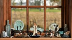 A windowsill in the original portion of the home holds glass bottles, nails, marbles, a toy horse and other items the Harshbargers found while working on the house.