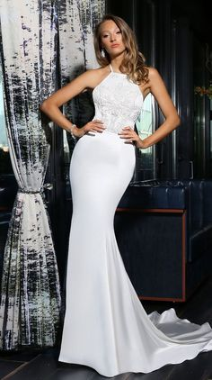 High neck, halter gown with fully beaded bodice and low back.