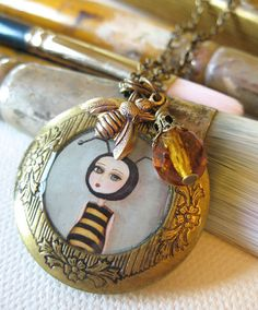 Bee Girl antique locket - made by painter Kris G. Brownlee on Etsy, $35.00