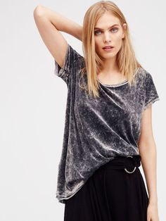 Simple, ultra cozy velvet tee featuring side vents and a slight high-low hem for an effortless shape. Unfinished edges create a cool lived-in look.