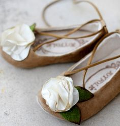 Mya slippers. Tan faux suede is sure to match with everything!  Shoes feature delightful little ties and textured little cream satin flower with hand cut felt leaves. Lined in organic cotton. Tan rubber soles. Vegan! #girls #handmade