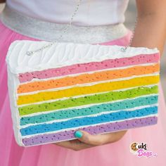 RAINBOW PIECE OF CAKE PURSE / BAG Itsy Bitsy Tiny Miny-Piece of cake rainbow purse/clutch bag, a great mix of multiple flavours glazed with white buttercream icing. A handmade clutch / bag which fits perfectly with a flower power girl. Handmade Clutch, Handmade Purses, Rainbow Layer Cakes, Cake Rainbow, Whipped Cream Cakes, White Buttercream, Rainbow Sprinkles, Piece Of Cakes, Clutch Bag