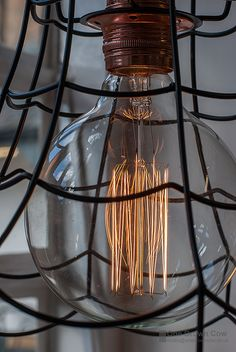 Vintage inspired globe light bulb. Based on the original Edison light bulbs these filament bulbs are purely for decorative use. The ornamental filament winding inside this bulb is affectionately known as a squirrel cage and rated at just 40w this bulb gives a soft warm glow. Here we have paired our bulb with and industrial style black wire cage light shade and a copper finish pendant with cotton coated cable. All items are UK rated only and available separately.