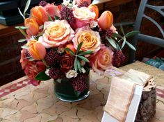 My florist wanted to added orange which I was hesitant about. But I like how the orange is in this arrangement.