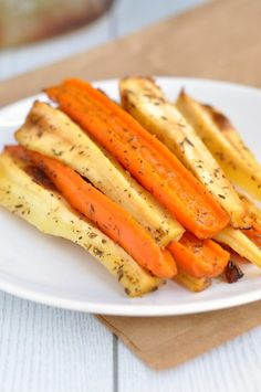 The Most Amazing Honey Roasted Carrots and Parsnips piled high on a plate