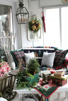 Common Ground: Christmas on the Sunporch . Love the use of the metal picnic basket. Christmas Front Doors, Christmas Porch, Little Christmas, White Christmas, Christmas Time, Christmas Decorations, Holiday Decor, Christmas Mantles, Porch Entry
