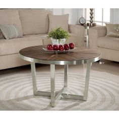Rustic contemporary style comes to life in the Axis Round Coffee Table. A steel plated frame holds the solid Acacia plank top w/ a parquet design pattern! Accent Furniture, Living Room Furniture, Outdoor Furniture Sets, Outdoor Decor, Rustic Contemporary, Round Coffee Table, Home Projects, Home Furnishings, Living Spaces