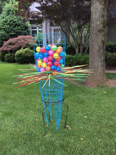 Giant Kerplunk game! Purchased 6 blue tomato cages at Home Depot and turned them upside down in a 20'' high plant stand, also purchased at Home Depot. I painted 3' bamboo skewers but you could also use bamboo tomato stakes. Ball pit balls are available at amazon or Toys R Us. Great youth group or carnival game.