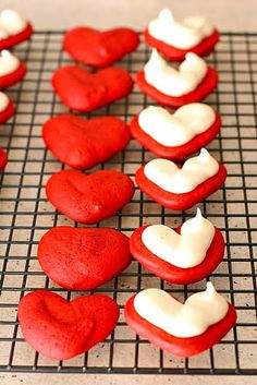 Darling heart shaped Valentine's Day Red Velvet Whoopie Pies. #red #velvet #cake #food #baking #dessert #Valentines #whoopie #pie