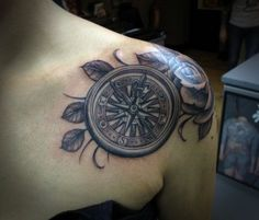 like the idea of flowers with the compass tattoo