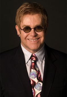 Sir Elton Hercules John CBE (born Reginald Kenneth Dwight on 25 March 1947) is an English singer, pianist, and composer. He has worked with lyricist Bernie Taupin as his songwriting partner since 1967.