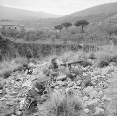 NEW ZEALAND FORCES ITALY 1944 (NA 12552)   A Vickers machine gun crew of the 2nd New Zealand Division in action during attacks on German positions at Monte Cassino.