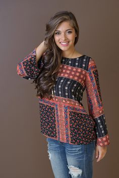 Boho inspired print long sleeve flowy fitting top with criss cross back detail.