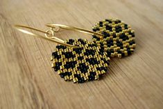 Earrings - Black and Gold Ice Crystals - Opaque Black and 24k gold plated delica glass beads - 24k gold plated sterling silver hoops on Etsy, 380,00kr