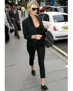 kate moss - simple black on black with practical loafers and great bag