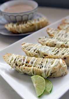 """Key Lime Biscotti & White Chocolate recipe - """"Unlike souffles or macaroons that can be a bit """"moody"""", you'll find biscotti turns out predictably well each time if the recipe is adhered to. Biscotti Cookies, Biscotti Recipe, Pistachio Biscotti, Almond Cookies, White Chocolate Recipes, Chocolate Drizzle, Chocolate Glaze, Chocolate Cookies, Cookie Recipes"""