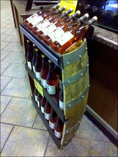 :Loving the use of this recycled wine barrel into a #retail #display...we could build something similar....#mainebucket