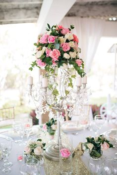 Chandelier centerpiece in combination with flowers for elegant and romantic look| Wedding at Kukua Punta Cana| Design Begokua| Photo by Karina Jensen