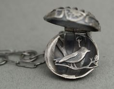 RF627  Bird in cage locket - oxidised stg silver (30mm D)  $650