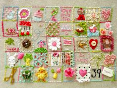 39 squares of needlepoint embroidery crewel sampler.  I love it.  Great way to use up odds and ends.