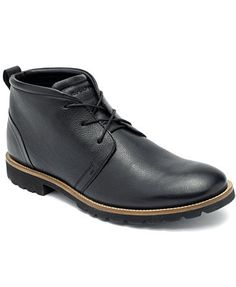 An everyday essential. Highlight casual get-ups with a pair of classic leather chukkas from Rockport. | Leather upper; rubber sole | Imported | Rockport men's chukka boots | Plain toe | Lace up | Pull