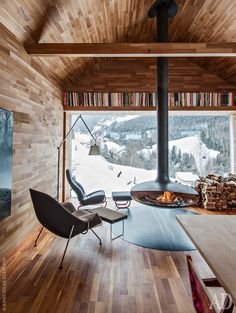 Modern cabin - I am really diggin those oversize covered porches. It is a must in a log cabin.