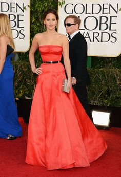 Jennifer Lawrence in Dior Couture by Raf Simons Announced as the new face of Christian Dior this past fall, Jennifer Lawrence took the burgeoning relationship to new heights in a waist-cinching, bust-enhancing red gown that solidified her Hollywood glamour chops.     Read more: Golden Globes Fashion 2013 - Golden Globes Best Dressed Celebrities - Harper's BAZAAR  Follow us: @Kerry Pieri on Twitter | HarpersBazaar on Facebook  Visit us at HarpersBAZAAR.com