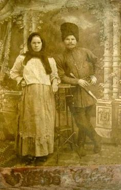 "Cossack with his young wife is clearly consistent. In the breast pocket of his beshmet - watch on a chain. In his dress suit with a correlation of the Caucasian peoples. Woman dressed simply, wide blouse and scarf mandatory. Without any decoration. ""Shirts and Sweatshirts sewed loose-fitting, no waist at half past three below the waist, with a zip on the back or side, with stand-up collar and long sleeves or elbow length, prisborennoe at the shoulder, and lower fitting."