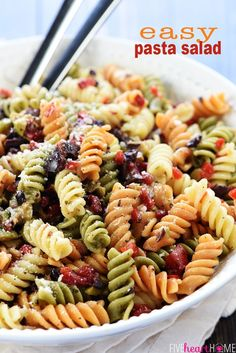 Easy Pasta Salad ~ tri-color garden rotini is studded with diced olives and pimentos, tossed with a zesty homemade Italian dressing, and showered with Parmesan for a versatile summer side dish recipe! Tortellini, Homemade Pasta Salad, Easy Pasta Salad Recipe, Pasta Salad Recipes Cold, Easy Cold Pasta Salad, Healthy Pasta Salad, Best Pasta Salad, Rotini Pasta Recipes, Easy Pasta Recipes
