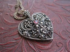 Sterling Silver Filigree Heart Necklace with Ruby.