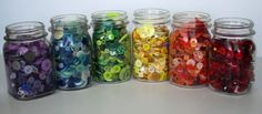 Sort Buttons by Color in Mason Jars - I've been doing this for year.  They make cute displays.