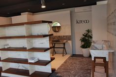 """Shiro"" marble and wood shelf, ""Loto"" and ""Nabhi Bowl No. 5"" natural marble sinks by Kreoo"