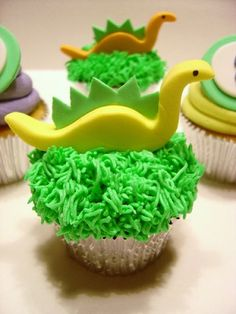 Todays cupcakes, courtesy of user mscoolicemui, are green grass cupcakes with adorable dinosaurs to top them off. Definitely too cute to eat!