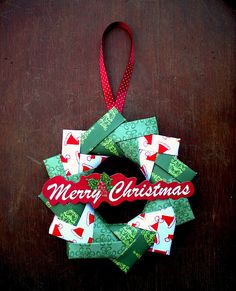 Origami Christmas Wreath:  To create it, you make 12 interlocking units from 12 pieces of paper. The diameter of the final wreath is the same as the size of one piece of paper.    http://angsandy.blogspot.com/search/label/Tutorial