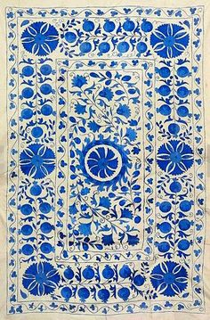 This beautifully handmade Uzbek Winter Garden pattern suzani, measuring 53 inches x 84 inches, features pomegranates, medallions, vines and flowers.