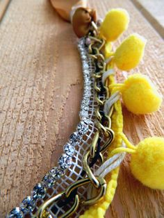 Pom Pom Necklace Fun and playful design, filed with color and fabrics. Yarn is so cheap and you can find in in loads of different colors so you can go wild and make a lot different combination from this necklace